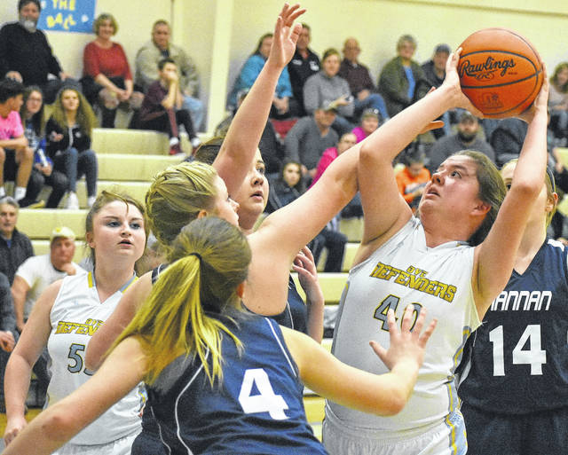 Ohio Valley Christian's Chloe Payne (40) attempts a shot against a group of Hannan defenders during the first half of the Lady Wildcats' 37-25 victory in Gallipolis.