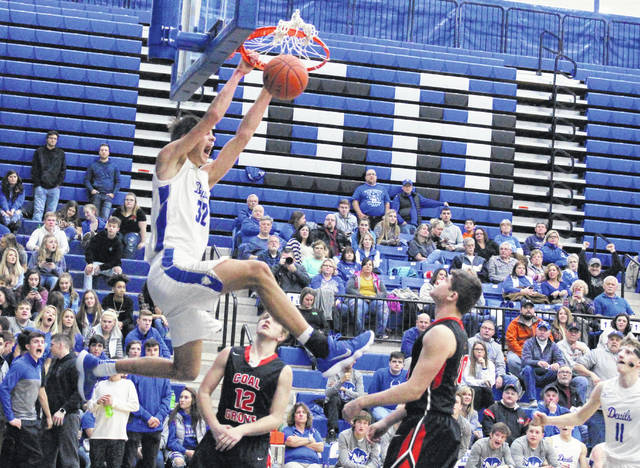 Gallia Academy sophomore Zach Loveday throws down a dunk during an OVC boys basketball contest against Coal Grove on Jan. 5 in Centenary, Ohio.