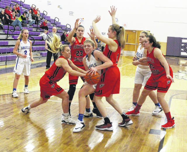 Gallia Academy freshman Maddy Petro is swarmed by a handful of Fairfield Union defenders during the second half of Wednesday night's Division II sectional semifinal contest at Logan High School in Logan, Ohio.
