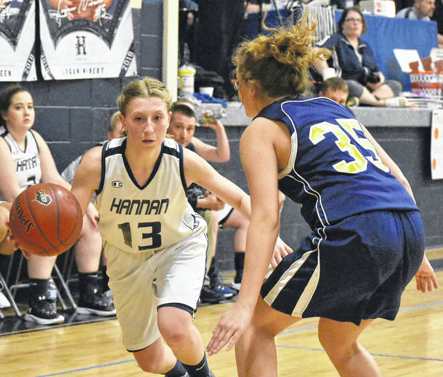 Hannan freshman Bailey Coleman (13) attempts to drive the lane against a Buffalo defender during Thursday night's 42-33 loss in Ashton, W.Va.