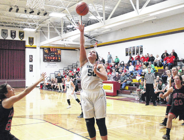 Eastern senior Elizabeth Collins (50) shoots a layup, during the Lady Eagles' 54-42 victory in the Division IV sectional final on Thursday in Rocksprings, Ohio.