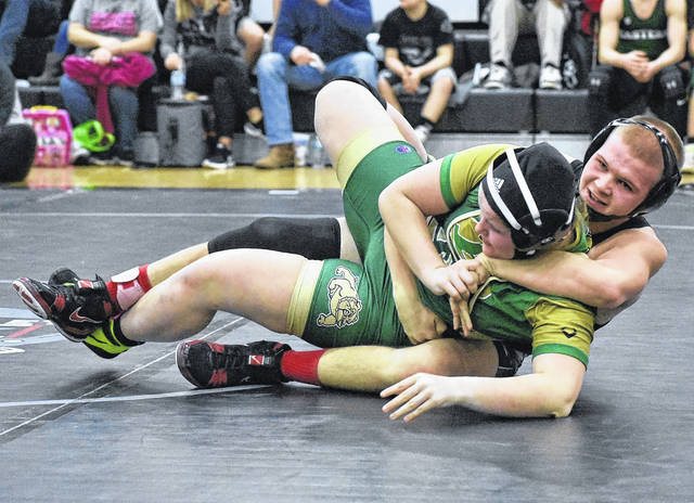 River Valley junior Derek Johnson locks in a hold on an opponent during the 152-pound match held at River Valley High School on Saturday at the 2018 TVC Championships in Bidwell, Ohio.