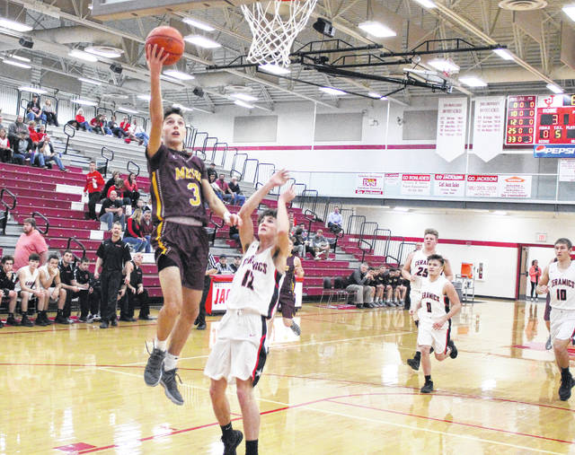 Meigs sophomore Weston Baer (3) releases a shot attempt in front of a Crooksville defender during the first half of Monday night's Division III sectional semifinal contest at Jackson High School in Jackson, Ohio.