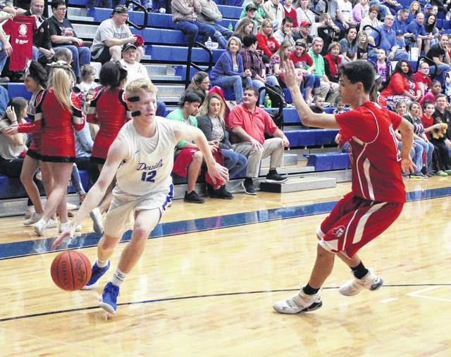 Gallia Academy senior Kaden Thomas, left, dribbles past Point Pleasant defender Casey Lowery during the first half of Tuesday night's non-conference basketball contest in Centenary, Ohio.