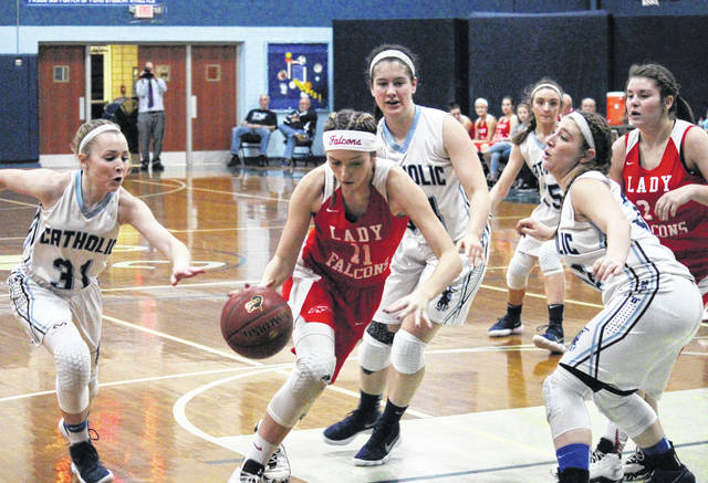 Wahama freshman Emma Gibbs (11) drives between a trio of PCHS defenders, during the Lady Falcons' 72-37 setback on Tuesday in Parkersburg, W.Va.