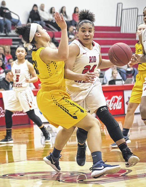 Rio Grande's Jaida Carter tries to drive past WVU-Tech's Katelyn Byrd during the first half of Saturday's River States Conference Women's Basketball Tournament semifinal game at the Newt Oliver Arena. The RedStorm earned a spot in Tuesday night's championship game with an 80-69 win over the Golden Bears.
