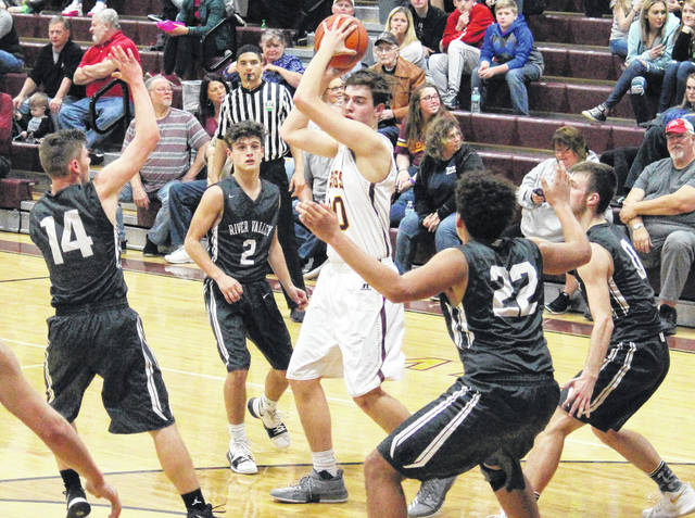Meigs sophomore Bobby Musser (center) is surrounded by Raiders Chase Caldwell (14), Layne Fitch (2) Darian Peck (22) and Jarret McCarley (0), during the Marauders' 57-47 victory on Monday in Rocksprings, Ohio.
