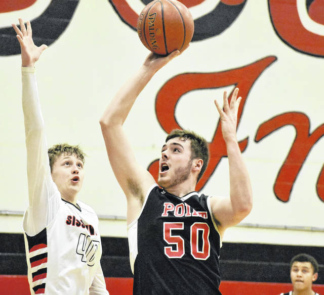 Point Pleasant senior Trace Derenberger (50) attempts a shot against a Sissonville defender during the second half of Monday night's 78-33 loss to the Indians at Calvin McKinney Gymnasium in Sissonville, W.Va.
