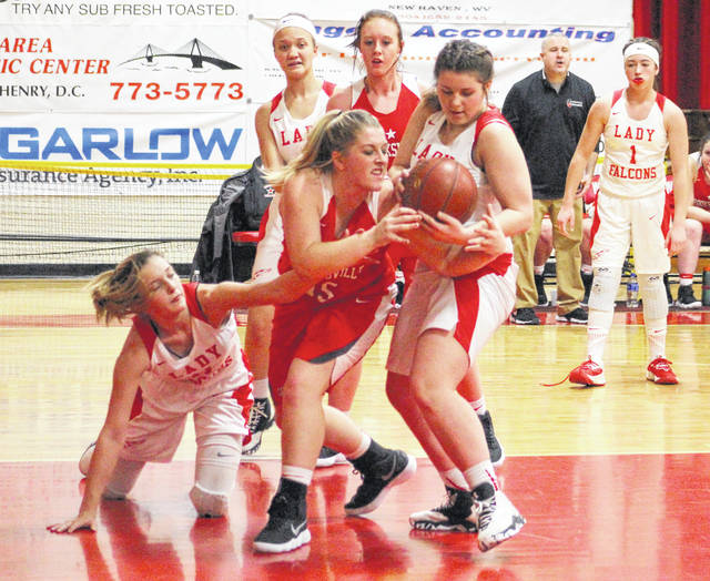 Wahama defenders Emma Gibbs, left, and Harley Roush battle for a loose ball with Crooksville's Daralyn Aier (15) during the first half of Thursday night's girls basketball contest at Gary Clark Court in Mason, W.Va.