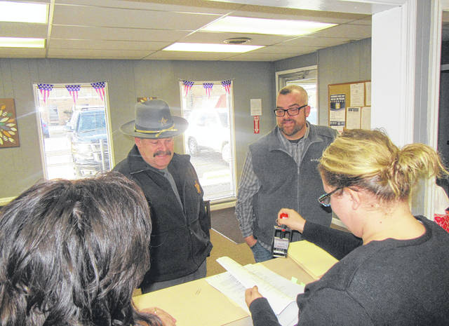 Sheriff Keith Wood and Commissioner Randy Smith submit paperwork to Angie Robson and Tammy Cline at the Meigs County Board of Elections for the placement of a levy and bond issue for the Meigs County Correctional Facility.