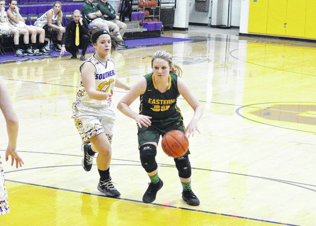 Eastern freshman Whitney Durst (30) dribbles past Southern senior Lauren Lavender (22), during the second half of the Lady Eagles' 71-39 victory on Monday in Racine, Ohio.
