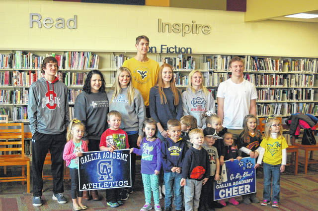 GAHS athletes read stories and talked with children from Bossard Library's story time this past Monday.