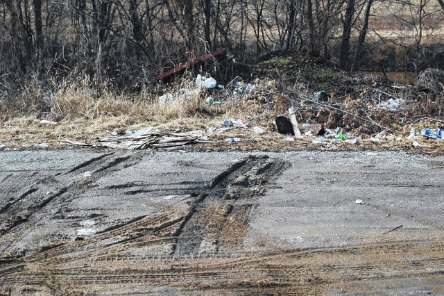 This is a common, illegal dump site where trash has been dumped without permission on the Niday Farm which is private property. Tire tracks are evident leading up to what appears to be recently dumped trash.