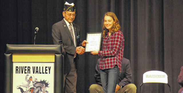 District Commander John Hood (left) of the American Legion presents a certificate of award to Julia Nutter (right) for placing as a state finalist.