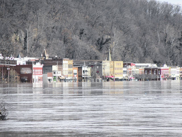 A look toward downtown Pomeroy on Monday morning from the McDonalds parking lot on West Main Street shows the height of the water along the downtown buildings and the parking lot gazebos.