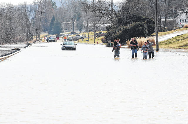 Gallipolis Fire Department responded to Ohio 7 near Ohio 218 in order to rescue four occupants of a flooded vehicle.