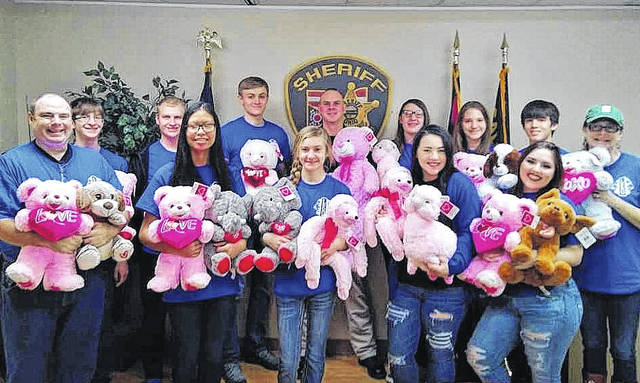 Pictured from left are Advisor Chris Homer, Leo Club Members Nicholas Sheets, Derek Henry, Sydney Crothers, Adam Sickels, Bethany Purdum, Sheriff Matt Champlin, Club Members Elizabeth Hoover, Makena Saunders, Hailey Deem, Braden Jamora, Brianna Sanders, and Advisor Sandra Mayes.