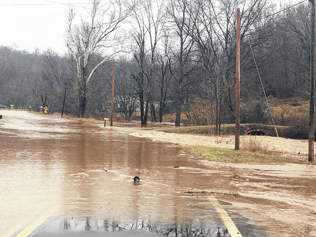 Heavy rains sent water over State Route 143 just off State Route 7 on Friday.