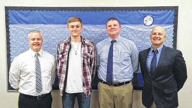 From left are Principal Josh Donley, Adam Sickels, Assistant Principal Robert Neal, and Superintendent Craig Wright. Sickels has received the honor of being recognized as a National Merit Scholar finalist, one of only 15,000 in the country.