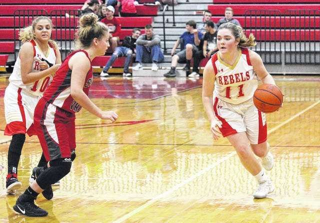 South Gallia senior Aaliyah Howell (10) sets a screen for teammate Erin Evans (11) during the Lady Rebels bout with Symmes Valley on Nov. 28, 2017, in Mercerville, Ohio.