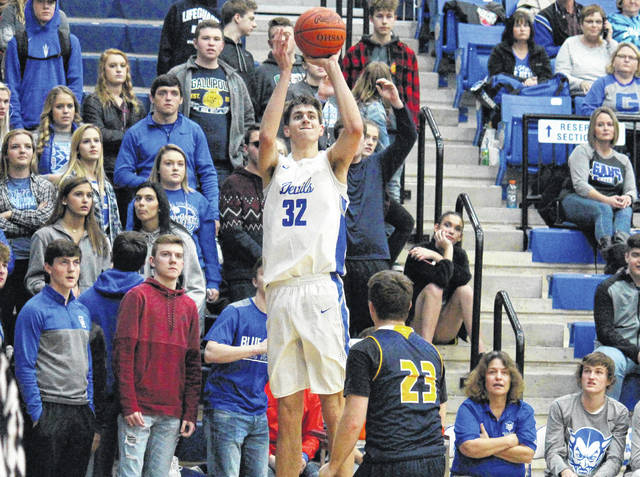 Gallia Academy sophomore (32) fires a three-pointer during the Blue Devils' win over South Point on Feb. 2 in Centenary, Ohio.