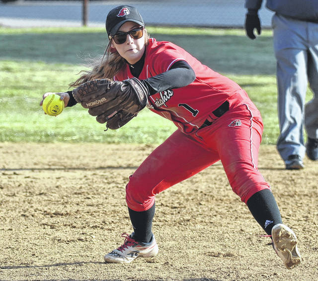 PPHS senior Kelsie Byus (1) attempts a throw to first base during the Lady Knights 5-4 win on Thursday night in Point Pleasant, W.Va.