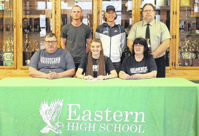 On Wednesday at Eastern High School, senior Jessica Cook signed her letter of intent to join the Shawnee State cross county and track and field teams. Sitting in the front row, from left, are John Cook, Jessica Cook, and Patty Cook. Standing in the back row are Eastern head coach Josh Fogle, SSU head coach Eric Putnam and EHS Principal Shawn Bush.