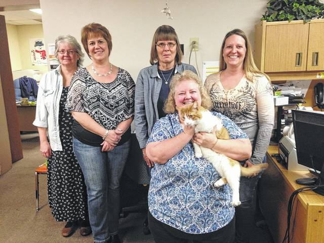 Otis, the Meigs County Courthouse cat, was the winner of last year's Cutest Pet Contest. Otis is pictured with his adopted family, back row, from left, Bev Collins from the Meigs County Auditor's Office, Meigs County Auditor Mary Byer-Hill, Denise Manuel from the auditor's office, Carrie Wamsley from Little, Sheets and Barr Law Office; front row, Maryann Parsons from the auditor's office and Otis.