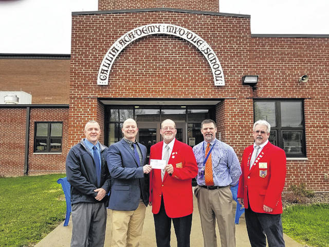 Pictured from left to right: Troy Johnson, Transportation/Safety Director; Craig Wright, Superintendent; Walter Brown, Elks Lodge Exalted Ruler; Shannon Mayes, Gallia Academy Middle School Teacher; and Bobby Marcchi, Elks Lodge Exalted Ruler Elect.