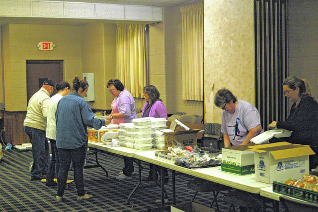 Members of the community came together to pack and deliver lunches Wednesday, based out of Elizabeth Chapel on Third Avenue.
