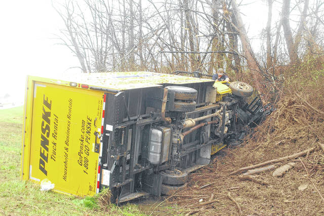 The truck reportedly rolled a single time onto its side after striking the ditch and adjacent trees.