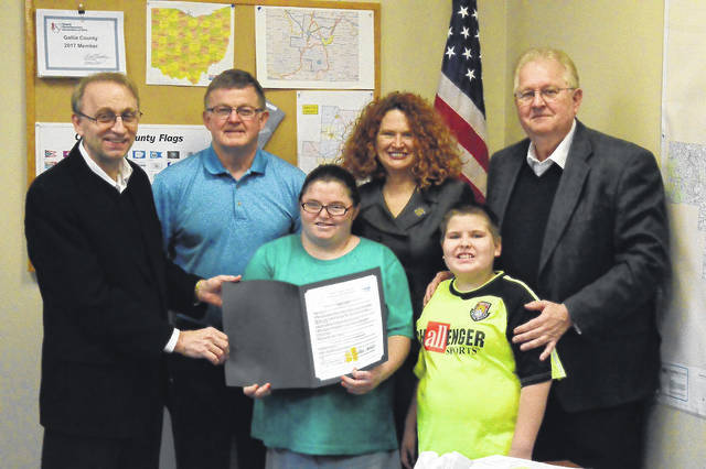 Standing from left to right are Gallia County Commissioner David Smith, Commissioner Brent Saunders, Guiding Hand Honor Student Chelsea Mullins, Gallia Boad of Developmental Disabilities Superintendent Pamela Combs, Guiding Hand Honor Student Malachi Markin and Commissioner Harold Montgomery. The commissioners proclaimed March Developmental Abilities Awareness Month Thursday.