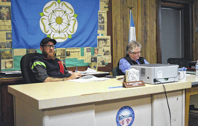 Rio Grande Mayor Matt Easter, left, discusses village concerns with the Rio Grande Village Council Tuesday evening. Rio Grande Fiscal Officer Jennifer Harrison runs through village finances, right.
