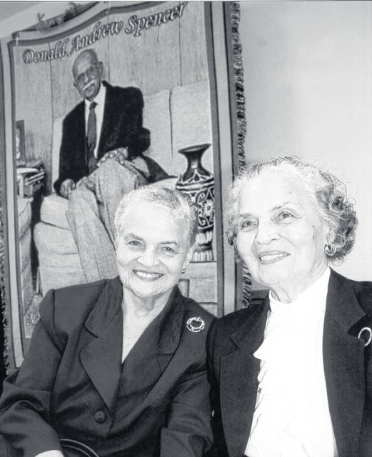 Marian Alexander Spencer, left, and her twin Mildred Malcolm, April 2010.