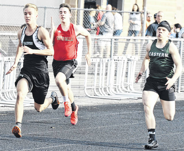 River Valley's Jared Reese (left) leads South Gallia's Gavin Bevan (center) and Eastern's Blake Newland (right) during the 100m dash at the River Valley Open on Tuesday in Bidwell, Ohio.