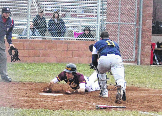 Meigs senior Zach Helton slides safely into home, making it a 4-3 game in the bottom of the seventh inning on Monday in Rocksprings, Ohio.