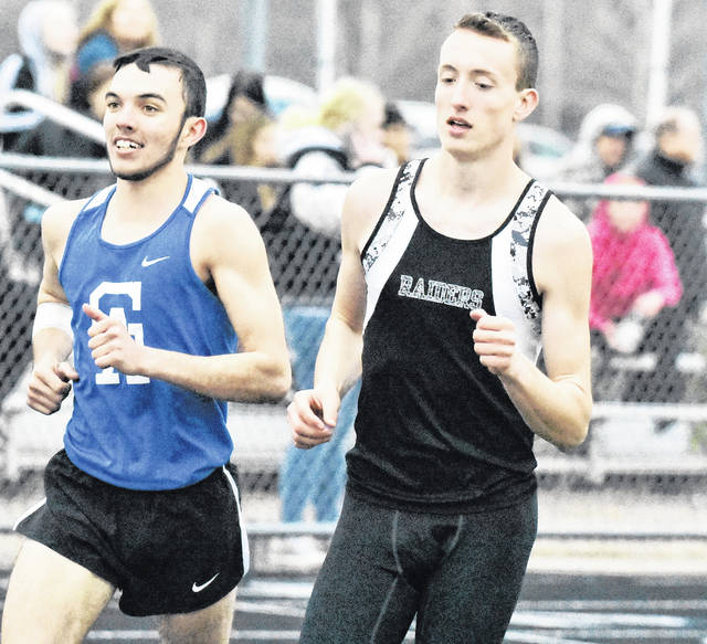 Gallia Academy's Caleb Greenlee (left) and River Valley's Nathaniel Abbott set the pace during 1600-meter run held at the Gallia County Meet on April 10 in Centenary, Ohio.