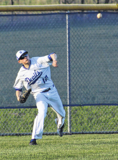 Gallia Academy senior Adam Sickels relays a throw from left field back to the infield during Friday night's OVC baseball contest against Portsmouth in Centenary, Ohio.
