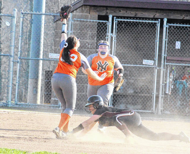 Meigs freshman Jerrica Smith slides back into second base, during the Lady Marauders' 15-5 victory over Nelsonville-York on Friday in Rocksprings, Ohio.