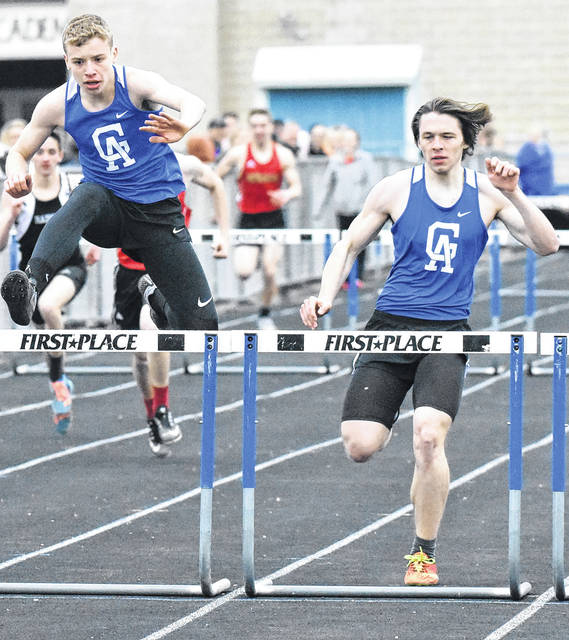 The Gallia Academy duo of Ian Hill, left, and Ezra Blain both approach obstacles in the 300m hurdles event at the 2018 Gallia County meet held Tuesday, April 10, in Centenary, Ohio.