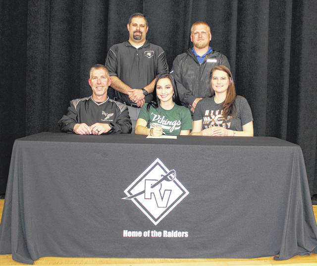 River Valley senior Kenzie Baker, seated center, will be continuing her cross country and track careers at the Division I level after signing a letter of intent with Cleveland State University on Wednesday, April 11, on the River Valley High School stage in Bidwell, Ohio. Kenzie is joined in the front row, from left, by her step-father and RVHS cross country coach Darin Smith and mother Leah Smith. Standing in back are RVHS athletic director Richard Stephens and RVHS track coach Brent Smith.