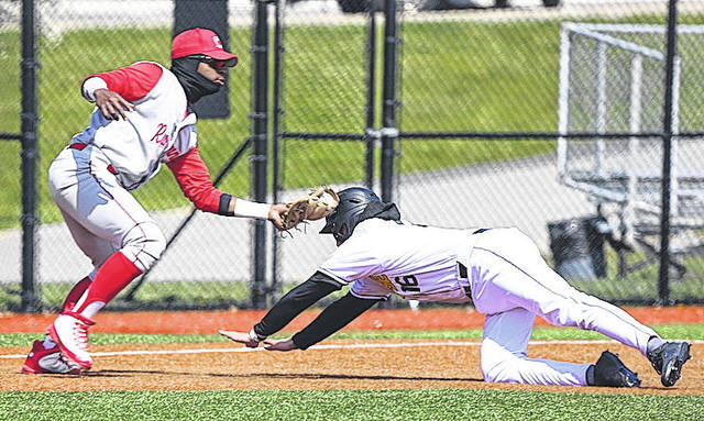 Rio Grande's Michael Rodriguez applies a tag to Northern Kentucky University's Will Haueter for a first inning out during Tuesday afternoon's game at the Bill Aker Baseball Complex in Highland Heights, Ky. The RedStorm knocked off the NCAA Division I Norse, 8-5.