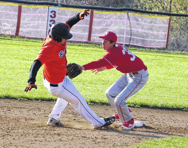 Wahama second baseman Jonathan Frye, right, applies a successful tag to a Belpre baserunner during the fifth inning of Tuesday night's TVC Hocking baseball contest in Mason, W.Va.