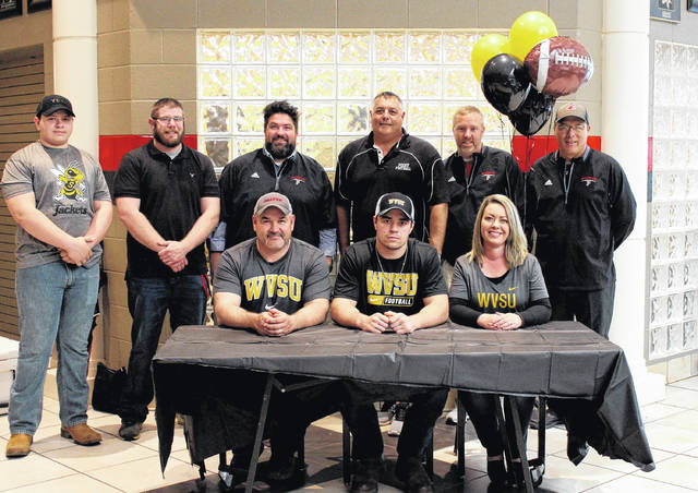 On Sunday at PPJSHS, senior Tucker Mayes signed his National Letter of Intent to join the West Virginia State football and baseball teams. Sitting in the front row, from left, are Tommy Mayes, Tucker Mayes and Crystal Mayes. Standing in the back row are Trenton Mayes, PPHS football assistant coach Daniel Tench, assistant coach Matt Cottrill, head coach David Darst, assistant coach Dave Withrow and assistant coach Terry Rollins.