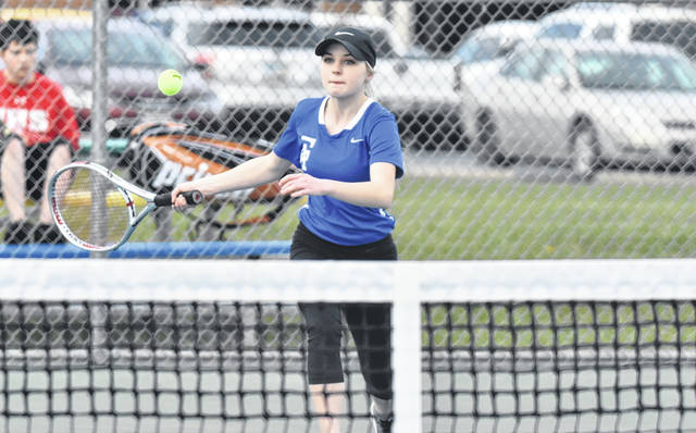 Gallia Academy sophomore Kirsten Hesson hits a forehand shot during an April 5 non-conference tennis match against Jackson at the Eastman Athletic Complex in Centenary, Ohio.