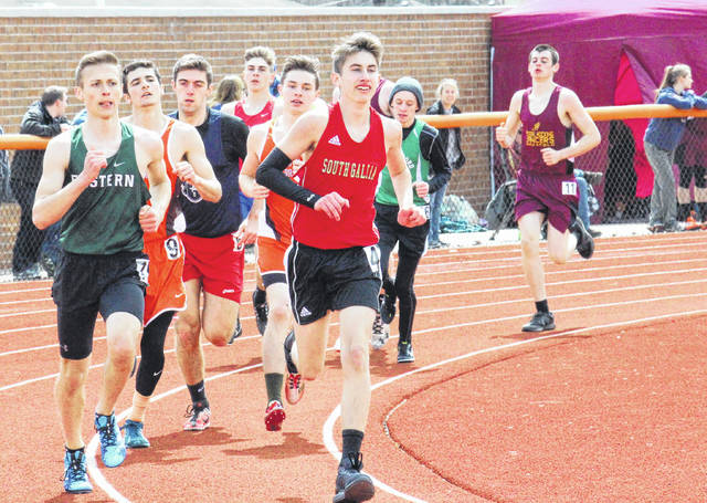 South Gallia's Garrett Frazee (center) and Eastern's Matt Clingenpeel (left) lead a pack of runner in the 1600m run, at the Rocky Brands Invitational on Saturday in Nelsonville, Ohio.