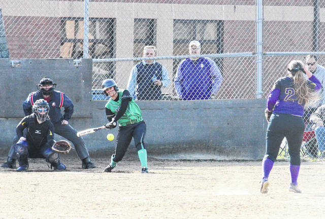 Eastern's Cera Grueser gets a hit off of Southern's Sydney Cleland (right), during the Lady Eagles' 8-2 win on Thursday in Tuppers Plains, Ohio.