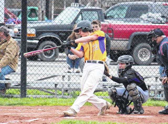 Southern junior Billy Harmon hits a double in the second inning of the Tornadoes' 28-1 victory on Friday in Racine, Ohio.