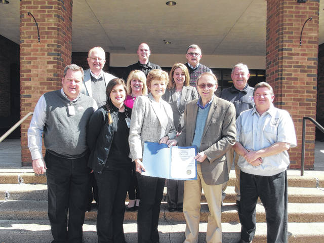Gallia Commissioners Proclaimed April 9-13 Week of Appreciation for first responders, health professionals, mental health professionals and others for their work fighting the opioid epidemic. First Row: Attorney Brent A. Saunders, Holzer Health Systems; Ryan Broomfield, Holzer Health Systems; Robin Harris, G-J-M ADAMHS Board Director; David K. Smith, President Gallia County Commissioners; Keith Wilson, Gallia County Assistant 911 Director Second Row: Harold Montgomery, Gallia County Commissioner; Sherry Daines, Gallia County 911 Director; Angela Stowers, G-J-M ADAMHS Board Assistant Director; Larry Boyer, Gallia County EMS Director Third Row: Matt Champlin, Gallia County Sheriff; Brent Saunders, Vice President Gallia County Commissioners