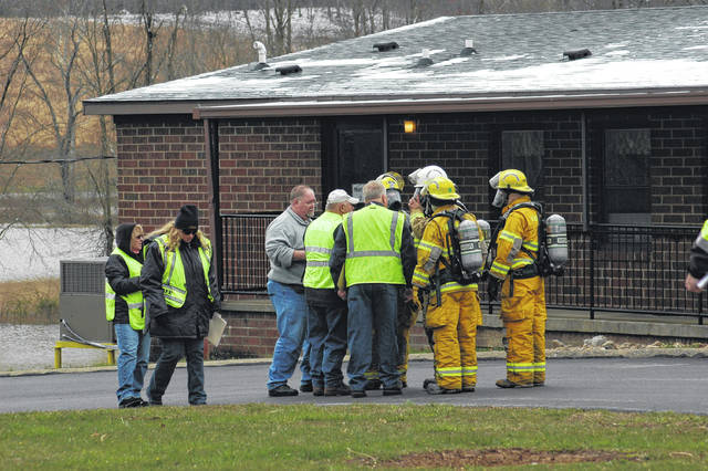 Vinton Firefighters speak with evaluators Saturday during the drill to explain and discuss how they handled the hazard material emergency.